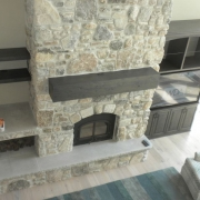 gray rustic hand scraped tv cabinet and fireplace